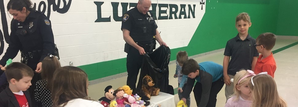 police receiving stuffed animals.